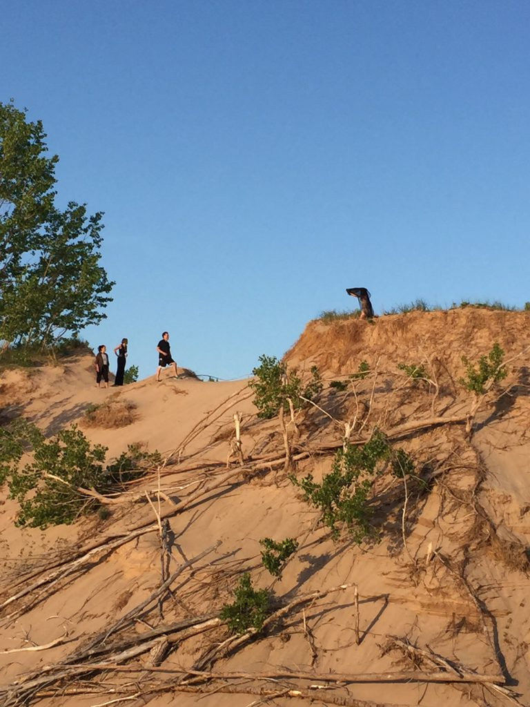 Metro Detroit photographer Jeff White, Stefana Rita, Ashley and Therese Sullivan and Brooke Hayes shooting in the Sleeping Bear Sand Dunes